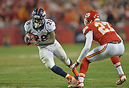 KANSAS CITY, MO - DECEMBER 01:  Running back Montee Ball #28 of the Denver Broncos rushes against defensive back Sean Smith #27 of the Kansas City Chiefs during the second half on December 1, 2013 at Arrowhead Stadium in Kansas City, Missouri.  Denver beat Kansas City 35-28.  (Photo by Peter Aiken/Getty Images) *** Local Caption *** Montee Ball;Sean Smith