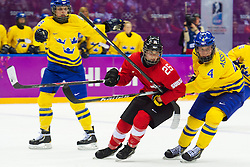 20.02.2014, Bolshoy Ice Dome, Adler, RUS, Sochi, 2014, Eishockey Damen, Spiel um die Bronzemedaille, im Bild Alina Mueller (SUI) gegen Jenni Asserholt (SWE) // during Womens Icehockey Match for Bronze Medal of the Olympic Winter Games Sochi 2014 at the Bolshoy Ice Dome in Adler, Russia on 2014/02/20. EXPA Pictures © 2014, PhotoCredit: EXPA/ Freshfocus/ Urs Lindt<br /> <br /> *****ATTENTION - for AUT, SLO, CRO, SRB, BIH, MAZ only*****