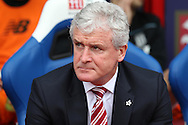 Mark Hughes, the Stoke City manager looks on from the dugout before k/o. Barclays Premier League match, Crystal Palace v Stoke City at Selhurst Park in London on Saturday 7th May 2016. pic by John Patrick Fletcher, Andrew Orchard sports photography.