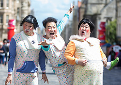 Street Performers take the streets to promote shows as part of the Edinburgh Fringe Festival<br /> <br /> Pictured: Ongals -  Babbling Comedy