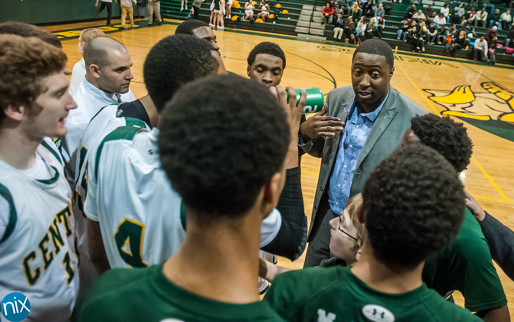 New Central Cabarrus head coach Kenyan Weaks talks with his team prior to a game against Northwest Cabarrus Friday night at Central Cabarrus High School. Central won the game 47-46.