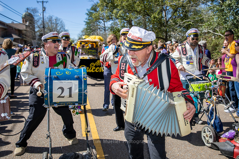 Lo Amp musicians , from left, Anthony Donado and Rick Stelma march down Main Street during the Krewe of Push Mow parade in Abita Springs, La.