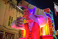 Waiter illuminated at night on float