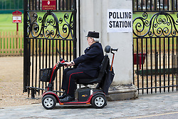 © Licensed to London News Pictures. 07/05/2015. London, UK. A Chelsea Pensioner, a resident for former service personnel at the Royal Chelsea Hospital, London, arrives at his local polling station station in west London this morning. Photo credit : Vickie Flores/LNP