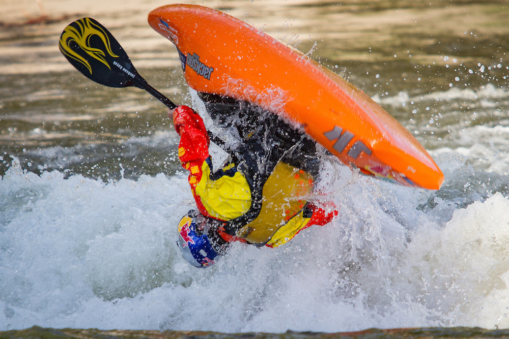 Freestyle kayaker challenges the wave at Salida Boat Ramp.