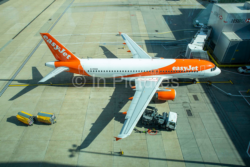An EasyJet Airbus A320-214 refuelling for the next flight at gate 101 on 16th October 2019 at Gatwick airport north terminal, United Kingdom.