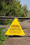 Rattlesnake warning sign in Ballona Wetlands, Playa Vista, Los Angeles, California, USA