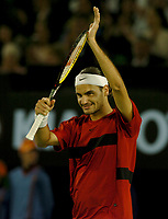 MELBOURNE, AUSTRALIA - JANUARY 30: Roger Federer celebrates his victory during day 12 of the Australian Open January 30, 2004 in Melbourne, Australia. (Photo by Sportsbeat) *** Local Caption *** -