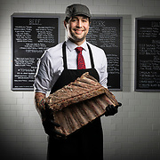 Kyle Cardwell the head butcher at Macelleria poses for a portrait. Macelleria is located at 2474 E. Main St. in Bexley. (photo by Leonardo Carrizo)