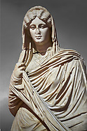 Roman statue of young Faustina. Marble. Perge. 2nd century AD. Inv no 3045 . Antalya Archaeology Museum; Turkey. Against a grey background .<br /> <br /> If you prefer to buy from our ALAMY STOCK LIBRARY page at https://www.alamy.com/portfolio/paul-williams-funkystock/greco-roman-sculptures.html . Type -    Antalya     - into LOWER SEARCH WITHIN GALLERY box - Refine search by adding a subject, place, background colour, museum etc.<br /> <br /> Visit our ROMAN WORLD PHOTO COLLECTIONS for more photos to download or buy as wall art prints https://funkystock.photoshelter.com/gallery-collection/The-Romans-Art-Artefacts-Antiquities-Historic-Sites-Pictures-Images/C0000r2uLJJo9_s0