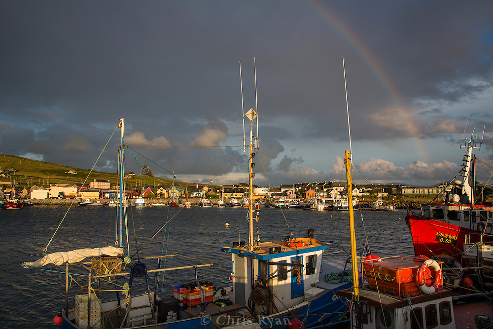 Rainbow over harbor and town of Dingle, County Kerry, Ireland