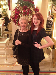 Emma with her mother Pat at The Ritz in 2013 after Pat's first successful cancer treatment. Emma McCauley, 26, of Barking, East London had to undergo a double mastectomy just weeks after losing her mother to breast cancer, discovering she herself had breast cancer and keeping it a secret whilst caring for her mother in her final weeks. London, July 31 2019.