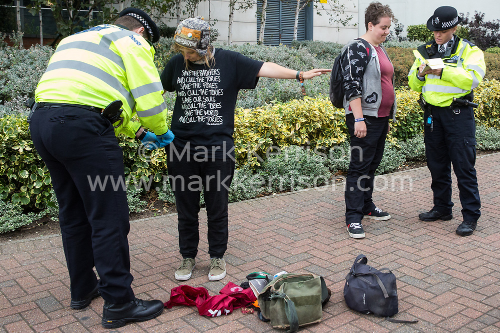 London, UK. 3 September, 2019. Metropolitan Police officers carry out a stop and search on activists attending the second day of a week-long carnival of resistance against DSEI, the world's largest arms fair, which is being hosted by ExCel London. The second day's events were organised around a theme of No Faith In War and were attended by representatives of many faith groups including a significant number of Quakers.