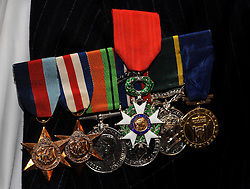 The Legion d'honneur, France's highest distinction, sit on top of other campaign medals as fourteen veterans were honoured for their role in securing France's liberation during the Second World War, with many having taken part in the June 1944 D-Day landings, given to them by the French Ambassador Sylvie Bermann during a ceremony at the Ambassador's residence in Kensington, London.
