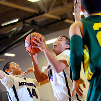121413  Adron Gardner/Independent<br /> <br /> Miyamura Patriot Jeremy Bill (14), center, lines up a shot  during the Eddie Peña Classic Basketball Tournament in Grants Saturday.