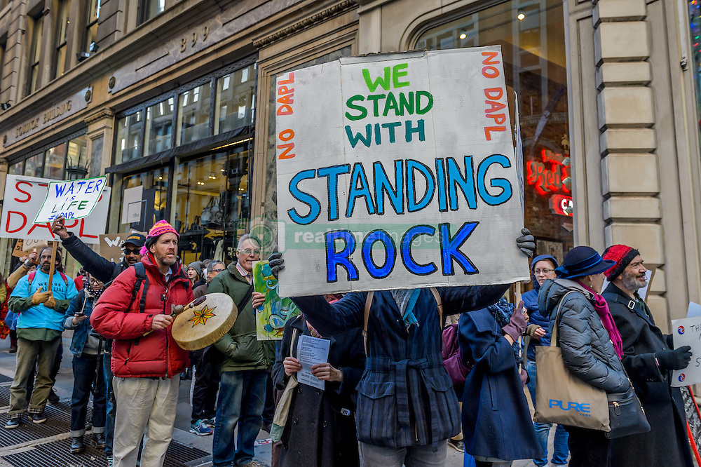 December 4, 2016 - New York, NY, United States - Hundreds of New York activists participate on a march organized by The Climate Mobilization in solidarity with water protectors as 2000 veterans deploy to North Dakota, demanding an end to main stream media silence on  Standing Rock. (Credit Image: © Erik Mcgregor/Pacific Press via ZUMA Wire)