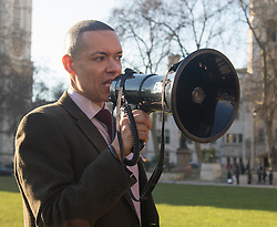 "Westminster, London, January 19th 2016. Students hold an ""emergency protest"" in Parliament Square and later blocking Westminster Bridge, against the cutting of maintenance grants. ""It took just 18 MPs 90 minutes to scrap maintenance grants for the million poorest students, without a debate in Parliament in a backroom committee"" PICTURED: Labour Shadow Energy Minister Clive Lewis addresses the gathering . ///FOR LICENCING CONTACT: paul@pauldaveycreative.co.uk TEL:+44 (0) 7966 016 296 or +44 (0) 20 8969 6875. ©2015 Paul R Davey. All rights reserved."