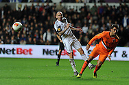 Jonjo Shelvey  of Swansea city. UEFA Europa league match, Swansea city v Valencia at the Liberty Stadium in Swansea on Thursday 28th November 2013. pic by Andrew Orchard, Andrew Orchard sports photography,