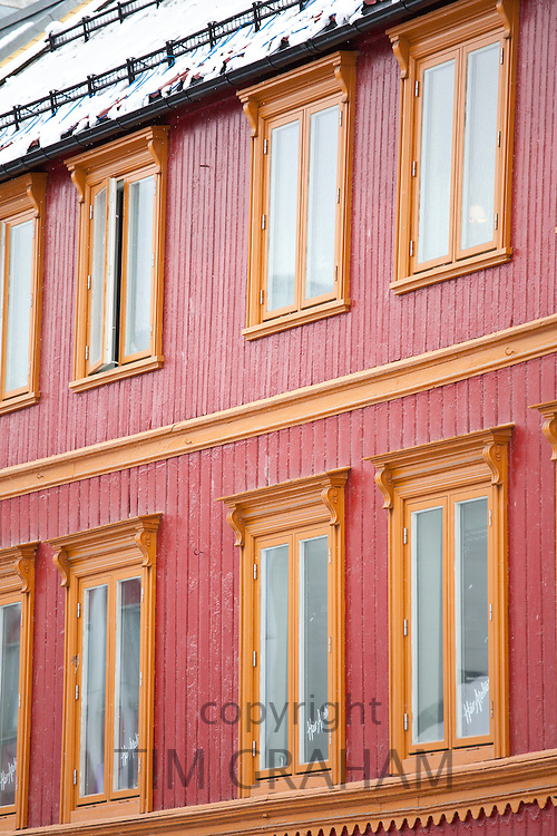 Traditional architecture and snow guards on roof in Storgata in city of Tromso, in the Arctic Circle in Northern Norway