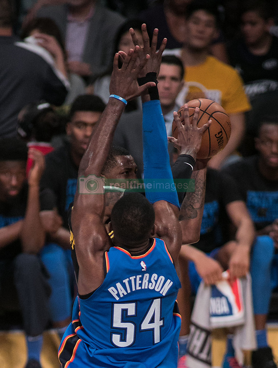 February 8, 2018 - Los Angeles, California, U.S - Kentavious Caldwell-Pope #1 of the Los Angeles Lakers goes for a layup against  Patrick Patterson #54 of the Oklahoma Thunder during their NBA game on Thursday February 8, 2018 at the Staples Center in Los Angeles, California. Lakers vs. Thunder. (Credit Image: © Prensa Internacional via ZUMA Wire)