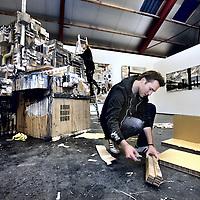 Nederland, Amsterdam , 27 november 2012..Beeldend Kunstenaar Aldo van den Broek voor een kunstwerk van hem uit de serie Made in Berlin te bewonderen in galerie New Dakota..Dutch artist Aldo van den Broek at his exhibition Made in Berlin  in gallery New Dakota.