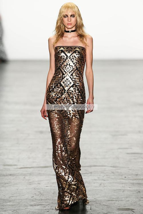 A model walks the runway wearing Tadashi Shoji Fall 2016 during New York Fashion Week on February 12, 2016