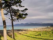 The sun breaks through the clouds on the south side of Kaikoura, Canterbury, New Zealand