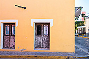 A brightly painted Spanish colonial style building in the Barrio Antiguo or Spanish Quarter neighborhood adjacent to the Macroplaza Grand Plaza in Monterrey, Nuevo Leon, Mexico.