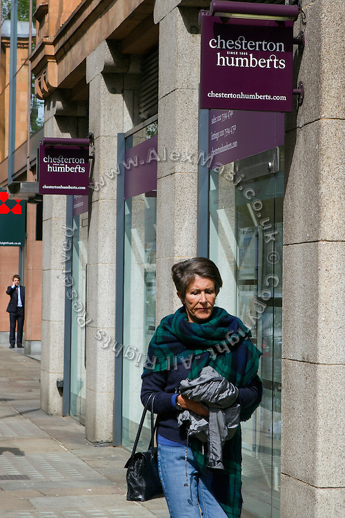 A woman is walking past the office of Chesterton Humberts, 60 Sloane Ave, Chelsea, London, United Kingdom.<br /> <br /> CREDIT: Alex Masi for The Wall Street Journal<br /> CHESTERTON<br /> <br /> The name of London real-estate agency Chesterton Humberts exudes English affluence. But in early 2011, as Libya was engulfed in revolution, a substantial stake in the firm was quietly acquired by the wealthy family of a longtime lieutenant to Moammar Gadhafi, according to a person with direct knowledge of the investment.