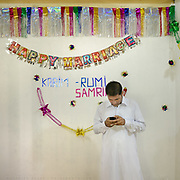 Karim, a newly married, upload pictures to his phone.<br /> Love marriage of Karim and Samrina, in Sost village, upper Hunza.