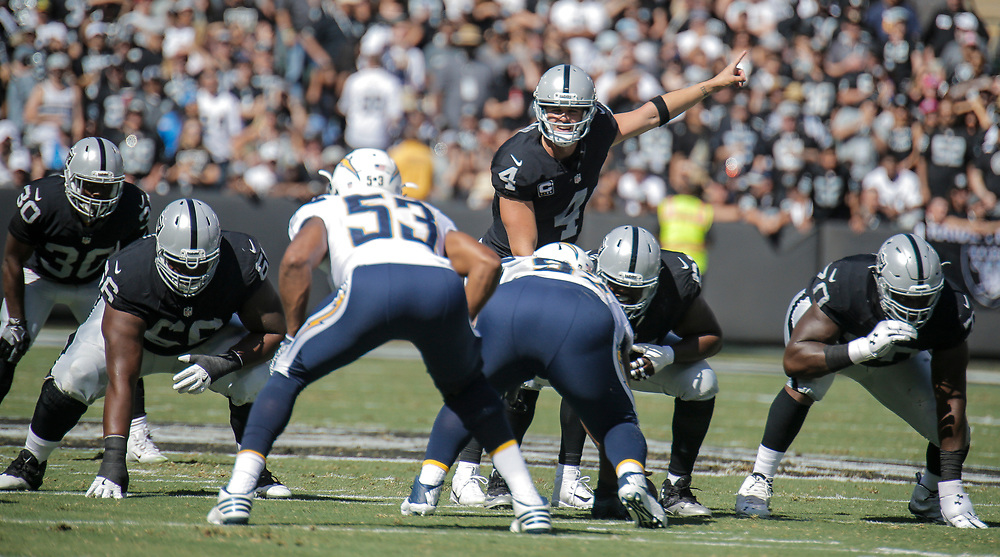 Oct 09 2016 - Oakland U.S. CA - Raiders Derek Carr threw a go-ahead 21-yard touchdown pass to Michael Crabtree on a fourth-and-2 gamble and added another TD pass to Amari Cooper to lead the Oakland Raiders to a 34-31 victory over the mistake-prone San Diego Chargers at O.co Coliseum Stadium Oakland Calif. Thurman James