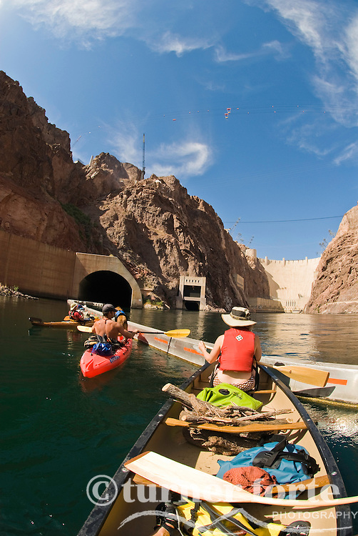 Paddlers check out The Hoover Dam from The Black Canyon, Nevada.