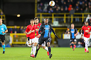 Club Brugge defender Clinton Mata (77) clears the ball from Manchester United midfielder Bruno Fernandes (18) during the Europa League match between Club Brugge and Manchester United at Jan Breydel Stadion, Brugge, Belguim on 20 February 2020.