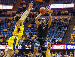 Feb 18, 2019; Morgantown, WV, USA; Kansas State Wildcats guard Barry Brown Jr. (5) shoots a jumper during the first half against the West Virginia Mountaineers at WVU Coliseum. Mandatory Credit: Ben Queen-USA TODAY Sports