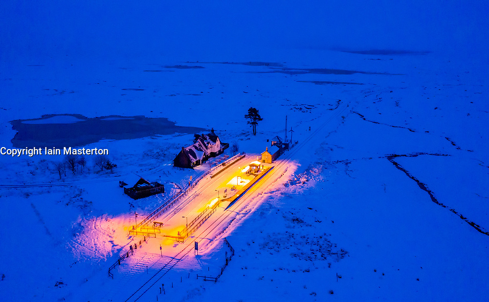Corrour, Scotland, UK. 28 January, 2020.  Aerial night view  of Corrour Station on the West Highland Line railway after heavy snow falls throughout Tuesday. Corrour Station is the highest railway in Britain at a height of 1338 feet above sea level. Iain Masterton/Alamy Live News.