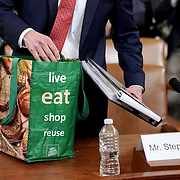 Republican counsel Stephen Castor returns from a break with his reusable grocery bag filled with documents at a House Judiciary Committee hearing to discuss the impeachment inquiry against President Trump with testimony from Democratic and Republican counsel on Monday, December 9, 2019.