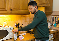 Husam struggles to do even the most basic tasks like making himself a cup of coffee, get dressed or tie his shoelaces, as he is right-handed it is too painful to use. Amazon delivery driver Husam Aljuburi, 29, of Ealing, West London, lost the top quarter of his middle finger after tearing it off in a letterbox as he delivered a parcel at a home in Slough. London, April 09 2019.