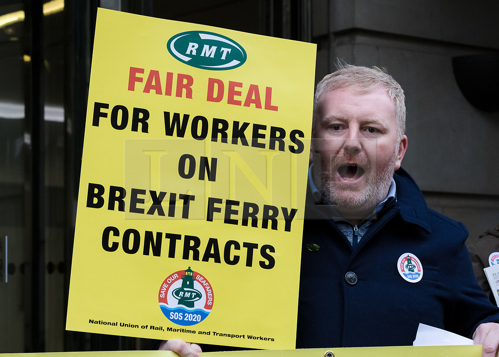 © Licensed to London News Pictures. 11/01/2019. London, UK.  A member of the National Union of Rail, Maritime and Transport Workers (RMT) takes part in a protest outside the Department for Transport to call for Transport secretary, Chris Grayling  provides a fair deal for workers on Brexit ferry contracts, including demands that new cross Channel ferries to be crewed by UK workers, the recognition of UK trade unions and full compliance with UK employment laws. The protest follows a no-deal Brexit contract awarded by the government to Seaborne Freight and the ongoing dredging of Ramsgate Harbour.  Photo credit: Vickie Flores/LNP