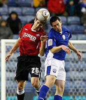 Photo: Steve Bond/Richard Lane Photography. Leicester City v Swansea City. FA Cup Third Round. 02/01/2010. Matty Fryatt (R) is beaten in the air by Girka Pintado
