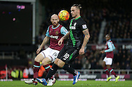 Marko Arnautovic of Stoke City  (10) and James Collins of West Ham keep their eyes on the ball.  Barclays Premier league match, West Ham Utd v Stoke city at the Boleyn Ground, Upton Park  in London on Saturday 12th December 2015.<br /> pic by John Patrick Fletcher, Andrew Orchard sports photography.