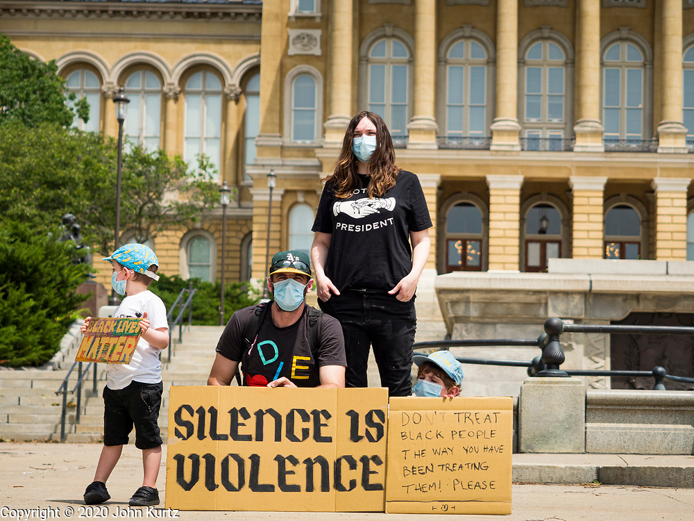 06 JUNE 2020 - DES MOINES, IOWA: A family in front of the Iowa State Capitol during a Black Lives Matter march Saturday. More than 1,000 protesters marched through downtown Des Moines to the state capitol to demand an end to police violence against Black people. The march was organized by Black Lives Matter and honored George Floyd, the unarmed Black man killed by Minneapolis police on 25 May 2020.         PHOTO BY JACK KURTZ