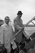 24/04/1965<br /> 04/24/1965<br /> 24 April 1965<br /> Footwear market finding mission leaves Dublin Airport. Mr Laurence F. Donohoe, President of the Footwear Adaption Association and Mr. Fintan Keogh, Coras Trachtala Trade Advisor, board a plane for Dusseldorf on the first leg of a joint fact-fining mission to discover the prospects for Irish footwear exports in the German and Dutch Markets.