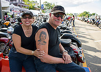 Sue and Len Greene from Troy, NY watching the bikes stream past on Lakeside Avenue for their  28th Motorcycle Week rally at Laconia.  (Karen Bobotas Photographer)