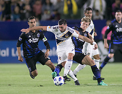 May 25, 2018 - Carson, California, U.S - Romain Alessandrini #7 of the LA Galaxy beats two defenders during their MLS game against the San Jose Earthquakes on Friday May 25, 2018 at the StubHub Center in Carson, California. LA Galaxy defeats the Earthquakes, 1-0. (Credit Image: © Prensa Internacional via ZUMA Wire)