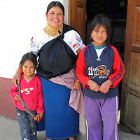 South America, Ecuador, Peguche. A local Ecuadorian woman and her children of Peguche, an Andean town in Ecuador.