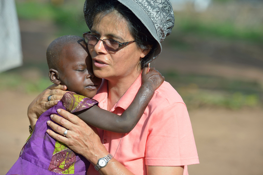 Sister Raquel Peralta, a Catholic nun from Paraguay, hugs a girl in a camp for more than 5,000 displaced people in Riimenze, in South Sudan's Gbudwe State, what was formerly Western Equatoria. Families here were displaced at the beginning of 2017 as fighting between government soldiers and rebels escalated.<br /> <br /> Peralta is a member of the Missionary Sisters Servants of the Holy Spirit, and works in South Sudan as part of Solidarity with South Sudan, an international network of Catholic groups working in the newly independent country. Solidarity and Caritas Austria have both supported efforts by the diocese to ensure that the displaced families here have food, shelter and water.