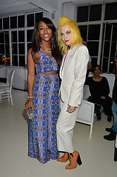 Left to right, ALEXANDRA BURKE and PAM HOGG at the OFFtheGRID event - a solar-powered party on a London rooftop to support our renewable energy future hosted by Dame Vivienne Westwood supported by the Trillion Fund at 151-155 New North Road, London N1 on 4th September 2014.