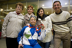 Mateja Pintar with bronze paraolympic medal with her family at welcome ceremony at Airport Joze Pucnik, on September 20, 2008, in Brnik, Slovenia. (Photo by Vid Ponikvar / Sportal Images)./ Sportida)