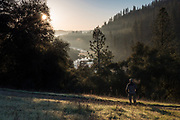 Hiker overlooking the South Fork American River at sunrise, El Dorado County, California