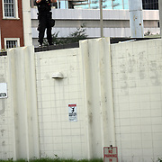 A strong police presence is seen throughout the city during the Republican National Convention in Tampa, Fla. on Wednesday, August 29, 2012.  This officer is watching the parade as it approaches the Convention Center. (AP Photo/Alex Menendez)